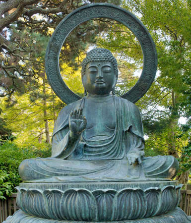 Sitting Bronze Buddha at San Francisco Japanese Garden in Golden Gate Park California photo