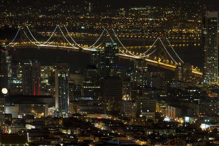 oakland: San Francisco California Cityscape with Oakland Bay Bridge Lit at Night Stock Photo