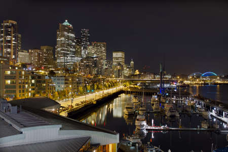 Seattle Washington Downtown Skyline Waterfront Pier Harbor Marina at Night photo