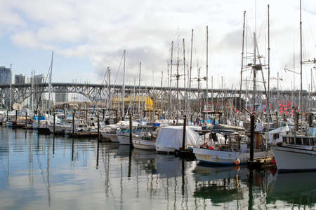 vancouver island: Yachts Moored by the Marina at Granville Island Bridge Vancouver BC Canada Stock Photo