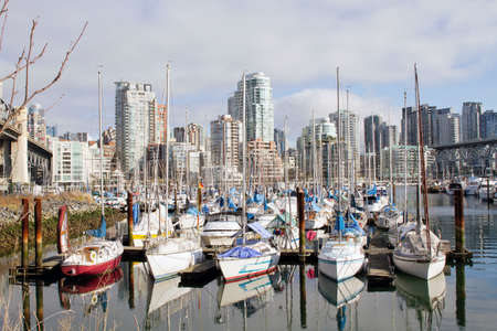 vancouver island: Yachts Moored by the Marina and Condominiums at Granville Island Bridge Vancouver BC Canada