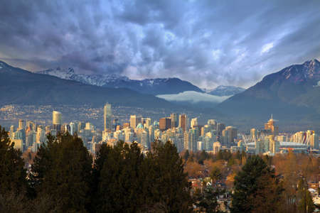 bc: Vancouver British Columbia Canada Downtown Skyline with Mountains Stock Photo