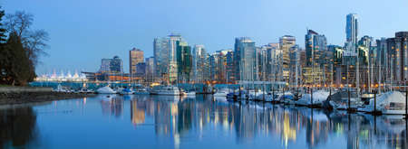bc: Vancouver BC City Skyline along False Creek by Stanley Park at Blue Hour Stock Photo