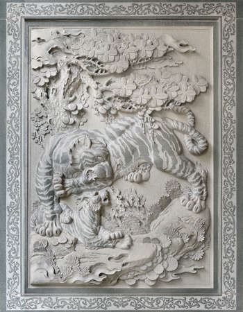chinese wall: Tiger with Cub Sculpture Relief Stone Carving Outside Chinese Temple