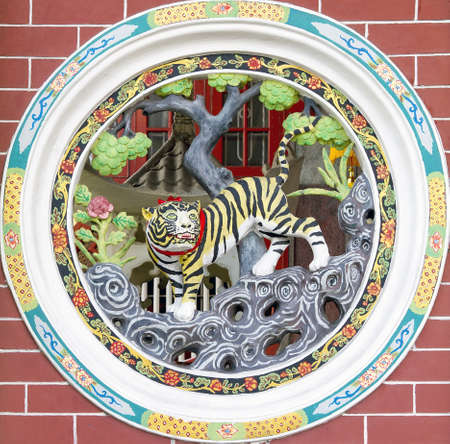 chinese wall: Circular Design Chinese Temple Wall Carving of Tiger