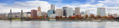 eastbank: Portland Oregon Downtown City Waterfront Skyline Along Willamette River with Blue Sky and White Clouds in Fall Season Panorama Stock Photo