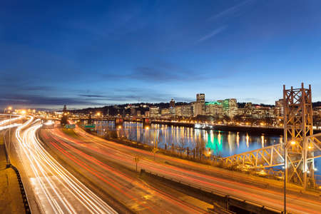 blue hour: Portland Oregon Downtown Cityscape with Freeway Traffic Light Trails during Evening Blue Hour Stock Photo