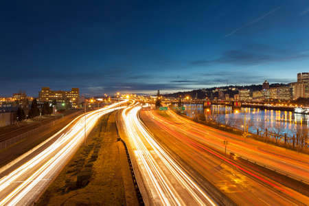 eastbank: Portland Oregon Downtown Cityscape with Interstate Freeway Traffic Light Trails during Evening Blue Hour Stock Photo