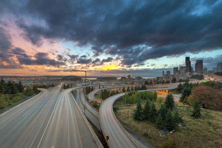 Colorful Sunset Over Seattle Washington City Skyline and Interstate Freeway