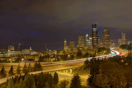 Seattle Washington Downtown City Skyline with Freeway Traffic Light Trails During Evening Blue Hour