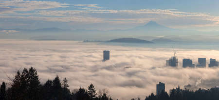 mount hood: Portland Oregon downtown cityscape with Mount Hood covered in Low Fog during Sunrise Panorama