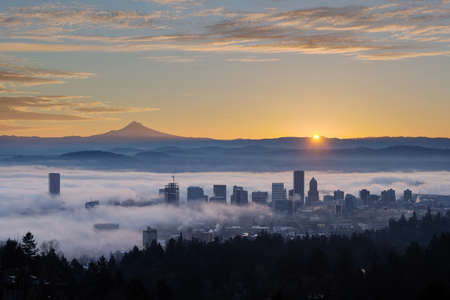 Sunrise over City of Portland Oregon and Mount Hood Covered in Low Fog Banks