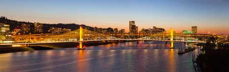 eastbank: Tilikum Crossing Bridge with Portland Oregon Downtown City Skyline at Dusk Panorama Stock Photo