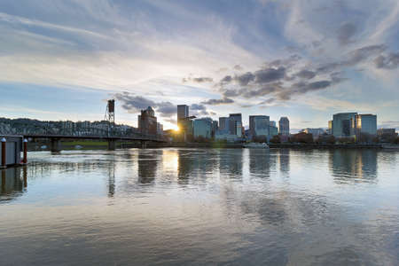 waterfront property: Sunset over the City of Portland Oregon downtown waterfront by Hawthorne Bridge along Willamette River Stock Photo