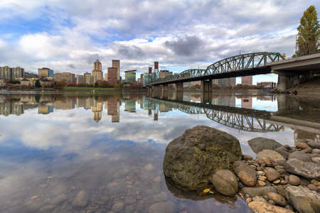 eastbank: City of Portland Oregon skyline by Hawthorne Bridge reflected on Willamette River