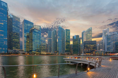 Singapore Central Business District city skyine by Marina Bay at sunset