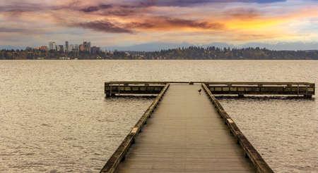 lake beach: The Dock at Madrona Beach on Washington Lake in Seattle during sunset.