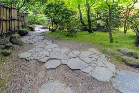 garden path: Stone Path Walkway with bamboo fence and landscaping at Japanese Garden