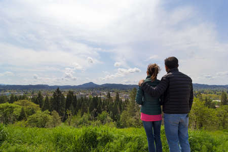 eugene: Couple at top of Skinner Butte Park enjoying view of downtown Eugene Oregon on a beautiful day