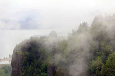gorge: Vista House on Crown Point at Columbia River Gorge Oregon covered in low clouds fog