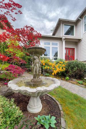 frontyard: Stone Water Fountain on Landscaped Frontyard of House in Residential Neighborhood in the Suburbs