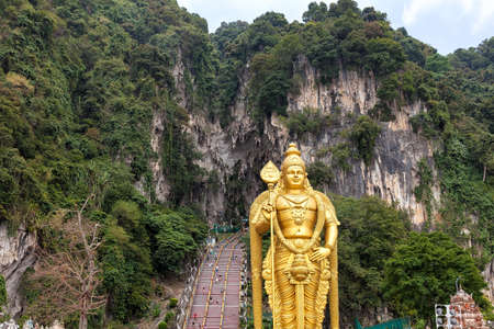 deity: Lord Murugan Hindu Deity Statue by 272 Steps Staircase at Batu Caves Entrance in Malaysia