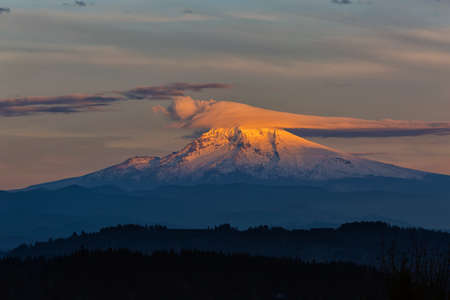 lenticular cloud: Lenticular Clouds over Mount Hood in Oregon during sunset