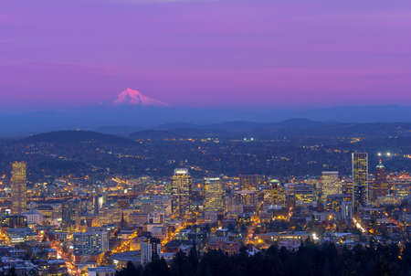 mt hood: Downtown Portland Oregon Cityscape with Mount Hood during evening time after sunset Stock Photo