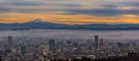 mount hood: Foggy Portland Oregon downtown cityscape and Mount Hood during sunrise panorama Stock Photo