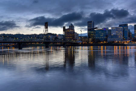 eastbank: Portland Oregon downtown city skylinw by Hawthorne Bridge along Willamette River at evening blue hour