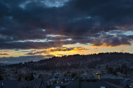 luxury house: Stormy sky over Happy Valley Oregon residential suburban neighborhood during sunset Stock Photo