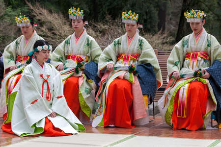 PORTLAND, OREGON - APRIL 1, 2017: Shrine Maidens from Tsurugaoka Hachimangu Shrine performing a dance at the grand opening of Portland Japanese Garden New Expansion Cultural Village Editorial