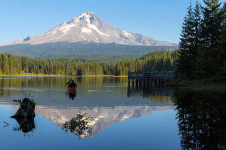 Canoeing and Fishing at Trillium Lake in Oregon with Mount Hood view on a blue sky sunny day