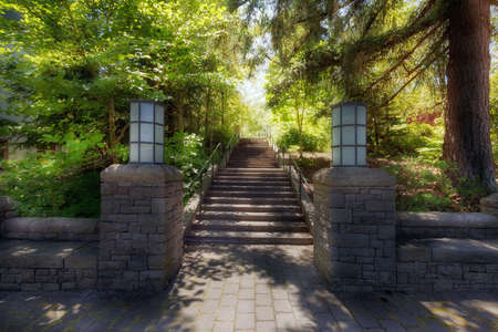 Garden path stone columns bench stairs paver bricks walkway and lamp posts in lush greenery in the park