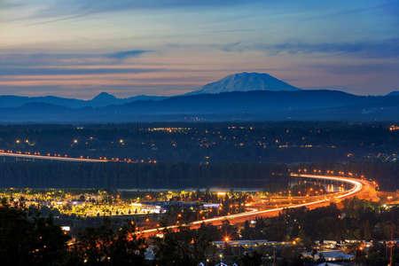 Glenn L Jackson Memorial Bridge I-205 segmental bridge spans Columbia River between Vancouver Washington and Portland Oregon during sunset