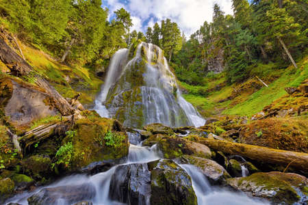 Upper tier waterfall of Falls Creek Falls in Washington State during summer