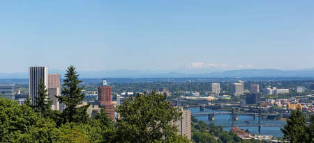 Portland Oregon downtown cityscape with bridges over Willamette River and Mt Saint Helens view panorama
