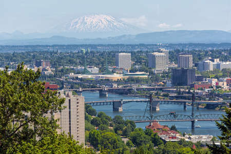 Portland Oregon downtown with bridges over Willamette River and Mount Saint Helens view Stock Photo