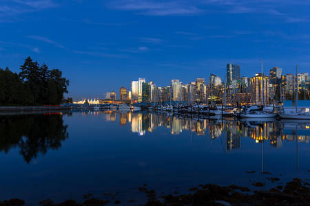 Reflection of Vancouver British Columbia Canada city skyline at Stanley Park during blue hour