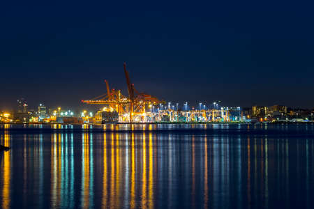 Port of Vancouver British Columbia Canada container cargo shipyaed during evening blue hour