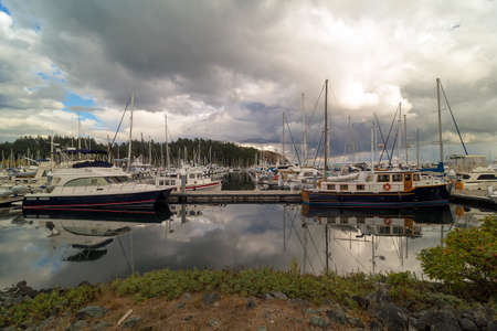 Boat Slips at Port of Anacortes Cap Sante Marina on Fidalgo Island in Washington State on a cloudy day Stock Photo