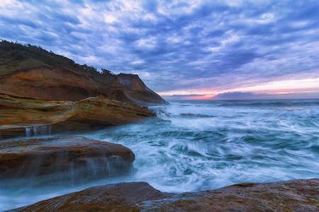 Pacific Ocean view at Cape Kiwanda Oregon Coast during sunset Stock Photo