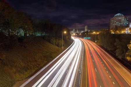 Interstate freeway through downtown Portland Oregon during evening rush hour traffic