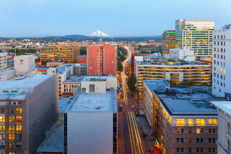 Portland Oregon downtown cityscape with Mount Hood view along street to Morrison Bridge with light trails