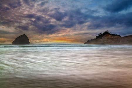 Chief Kiawanda Rock and Cape Kiwanda in Pacific City on the Oregon Coast at Sunset Stock Photo