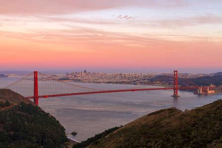 Colorful sunset sky over San Francisco city skyline and Golden Gate Bridge Stock Photo