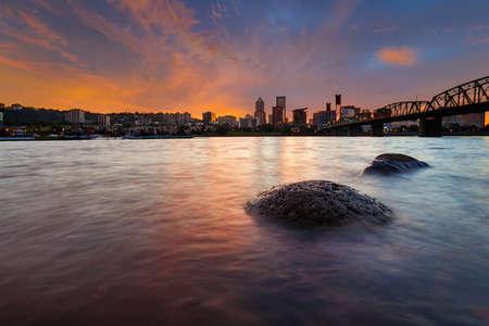 Portland Oregon downtown city skyline along Willamette River at Sunset