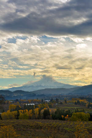 Clouds over Mount Hood and Hood River Valley fruit orchards in Oregon during fall season Stock Photo