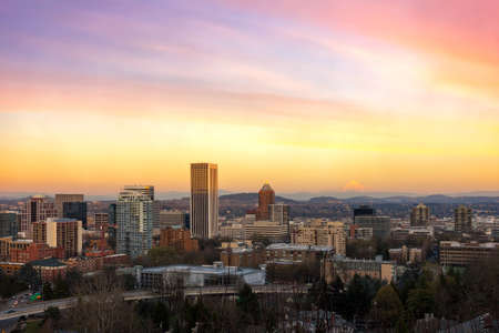 Portland Oregon downtown cityscape with Mt Hood view during sunset
