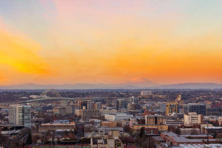 Portland Oregon downtown cityscape with Mt Saint Helens view during sunset at dusk